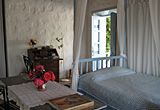 The main bedroom, looking to the entrance from the stairs - the Village house, Chora, Patmos