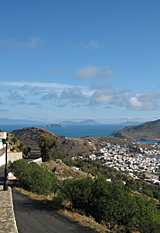 View northwards from Chora, the old town, to Skala, the port of Patmos, Greece, to the islands beyond